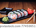 Sushi on a Wooden Table in Restaurant, Delicious Japanese Food, Sushi Rolls 77450651