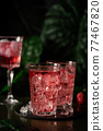Red drink cocktail or lemonade 77467820