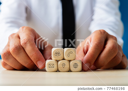 Wooden dices with contact icons of customer service 77468198