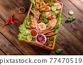 Composition of sausages, chicken, pork and shrimp prepared on grill, as well as vegetables prepared on grill with spices and herbs 77470519