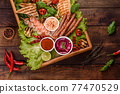 Composition of sausages, chicken, pork and shrimp prepared on grill, as well as vegetables prepared on grill with spices and herbs 77470529