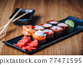 Sushi on a Wooden Table in Restaurant, Delicious Japanese Food, Sushi Rolls 77471595
