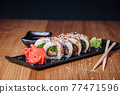 Sushi on a Wooden Table in Restaurant, Delicious Japanese Food, Sushi Rolls 77471596