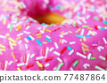Close up. Pink fresh donut with confetti.  77487864
