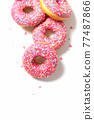 Cute pink yummy donuts. Isolated. Top view.  77487866