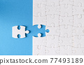 Last piece of puzzle lying separately on blue background 77493189