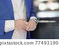 Man sitting at bar and hiding his wedding ring closeup 77493190