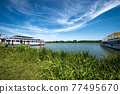 Mantua Lake or Mincio River with moored Ferry Boats - Lombardy Italy 77495670