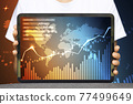 Close-up Of Business man's hand holding tablet showing stock market statistics gain profits and increase of chart positive indicators. Financial analysis, statistics. Concept of business strategy. 77499649