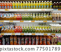PENANG, MALAYSIA -JUNE 25, 2020: Selected focused on fruit juices sold in commercial paper pack and bottles. Displayed on the chiller rack. Placed a price tag for the customer. 77501789