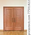 Wooden doors with bronze handles in a concourse 77501822