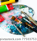 tubes of acrylic paint, palette and brushes on a white background 77503753