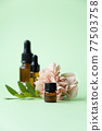 Essential oils , various bottles aromatherapy on a green background. Aromatherapy and perfumes concept 77503758