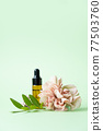 Essential oils , various bottles aromatherapy on a green background. Aromatherapy and perfumes concept 77503760