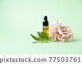 Essential oils , various bottles aromatherapy on a green background. Aromatherapy and perfumes concept 77503761