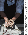 Close up picture of female ceramic artist arms in clay after making pottery. 77504667