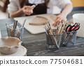 Detail from pottery work room - brushes and tools 77504681