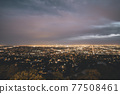 Beautiful Wide View over all of Los Angeles at Night with City Lights glowing in the distance 77508461