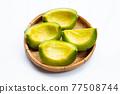 Tropical fruit, Thai cantaloupe or Muskmelon sliced in bamboo basket 77508744