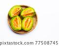 Tropical fruit, Thai cantaloupe or Muskmelon sliced in bamboo basket 77508745