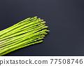 Fresh asparagus on dark background. 77508746