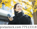 Woman in coat 77513318