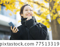 Woman in coat 77513319