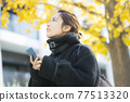 Woman in coat 77513320