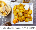 Dish of Spanish cuisine Patatas Bravas 77517095