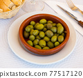 Close up of green olives 77517120