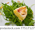 Camembert cheese with pine nuts and arugula 77517127