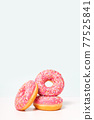 Fresh pink donuts in stack. Copy space.  77525841