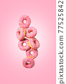 Cute pink donuts on pink background. Levitation.  77525842