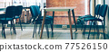 Coworking room space with tables and chairs 77526150