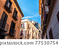 Traditional residential buildings in the quarter of Las Letras in Central Madrid 77530754