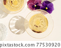 Champagne and grass styled stock scene 77530920
