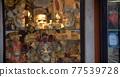 Venetian masks in glass show-window 77539728