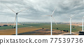 Drone point of view turbines of windmills. Spain 77539736