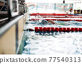 Swimming to the target during the race at the pool 77540313