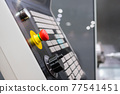 Control panel of cnc turning milling lathe machine at factory - close up 77541451