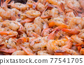 Close up view - process of grilling red shrimps, prawns on brazier - street food 77541705