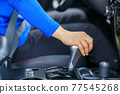 Driver driving car change the shifter 77545268