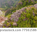 Amazing huge dragon statue at limestone mountain top near Hang Mua view point at foggy morning. Popular tourist attraction at Tam Coc, Ninh Binh. Vietnam travel landscapes and destinations. Vietnam 77561586