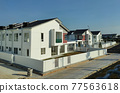SEREMBAN, MALAYSIA -APRIL 20, 2021: New double story luxury terrace house in Malaysia.  Construction almost completed. Designed by an architect with a modern and contemporary style.  77563618