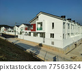 SEREMBAN, MALAYSIA -APRIL 20, 2021: New double story luxury terrace house in Malaysia.  Construction almost completed. Designed by an architect with a modern and contemporary style.  77563624