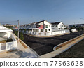 SEREMBAN, MALAYSIA -APRIL 20, 2021: New double story luxury terrace house in Malaysia.  Construction almost completed. Designed by an architect with a modern and contemporary style.  77563628