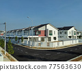 SEREMBAN, MALAYSIA -APRIL 20, 2021: New double story luxury terrace house in Malaysia.  Construction almost completed. Designed by an architect with a modern and contemporary style.  77563630