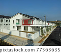 SEREMBAN, MALAYSIA -APRIL 20, 2021: New double story luxury terrace house in Malaysia.  Construction almost completed. Designed by an architect with a modern and contemporary style.  77563635