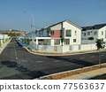 SEREMBAN, MALAYSIA -APRIL 20, 2021: New double story luxury terrace house in Malaysia.  Construction almost completed. Designed by an architect with a modern and contemporary style.  77563637
