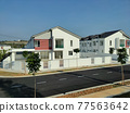 SEREMBAN, MALAYSIA -APRIL 20, 2021: New double story luxury terrace house in Malaysia.  Construction almost completed. Designed by an architect with a modern and contemporary style.  77563642